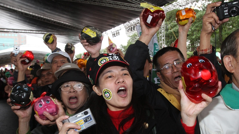Supporters of Taiwan's opposition Democratic Progressive Party presidential candidate Tsai Ing-wen gather during an election rally in Taipei, Taiwan, Saturday, Dec. 10, 2011.