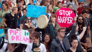 A protester holds up a 'Stop Harper' sign while marching with others during a rally held to show (Darryl Dyck / THE CANADIAN PRESS)