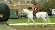 A member of Canada's Paralympic equestrian team, Jody Schloss practices for the 2012 games.