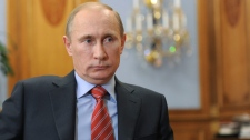 Russian Prime Minister Vladimir Putin meets with head of the Strategic Initiatives Agency Andrei Nikitin, unseen, in Moscow, Friday, Dec. 9, 2011. (AP Photo/RIA Novosti, Yana Lapikova, Pool)
