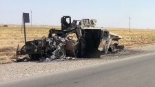 Burned Iraqi Humvee after battle for refinery