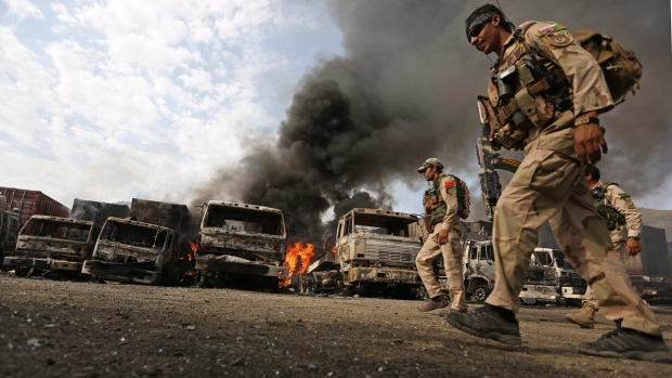 Afghan policemen react to suicide attack