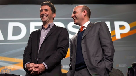 Federal NDP Leadership Candidate Paul Dewar (left) and Nathan Cullen share a laugh prior to the start of a town hall leadership meeting at the B.C. NDP Convention in Vancouver on Saturday, Dec. 10, 2011. (THE CANADIAN PRESS/Richard Lam)