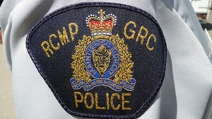 A group that represents RCMP members says a female officer has been shot in the arm near the community of Golden, in southeastern British Columbia