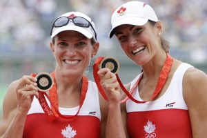 Canada's Melanie Kok, left, and Tracy Cameron celebrate with medals after taking the bronze medal in the Lightweight women's sculls final at the Beijing 2008 Olympics in Beijing, Sunday, Aug. 17, 2008. (AP Photo/Gregory Bull)