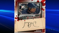 Georges Laraque wants the blood off his trading card.