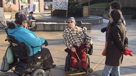 People with disabilities and their loved ones held a demonstration in New Westminster, B.C., to rally against Community Living BC service cuts. Dec. 11, 2011. (CTV)