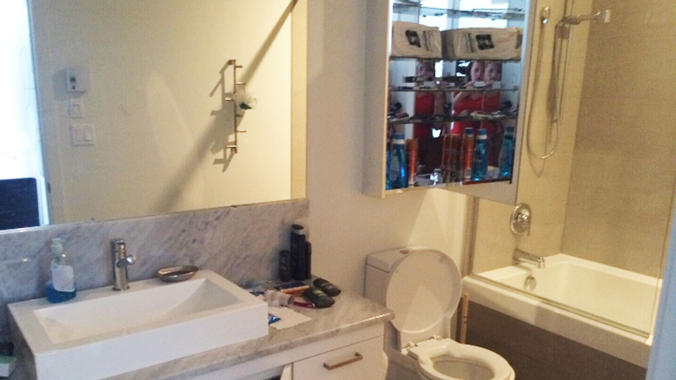 Here's a look inside the bathroom in the Montreal condo where three Quebec prison escapees were found hiding on Sunday, June 22, 2014.