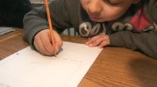 A child writing. (file)
