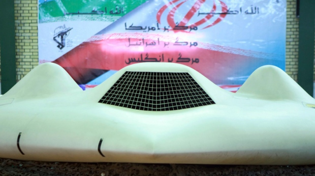 This photo released on Thursday, Dec. 8, 2011, by the Iranian Revolutionary Guards and taken at an undisclosed location claims to show the US RQ-170 Sentinel drone which Tehran says its forces downed earlier this week. (Sepahnews)