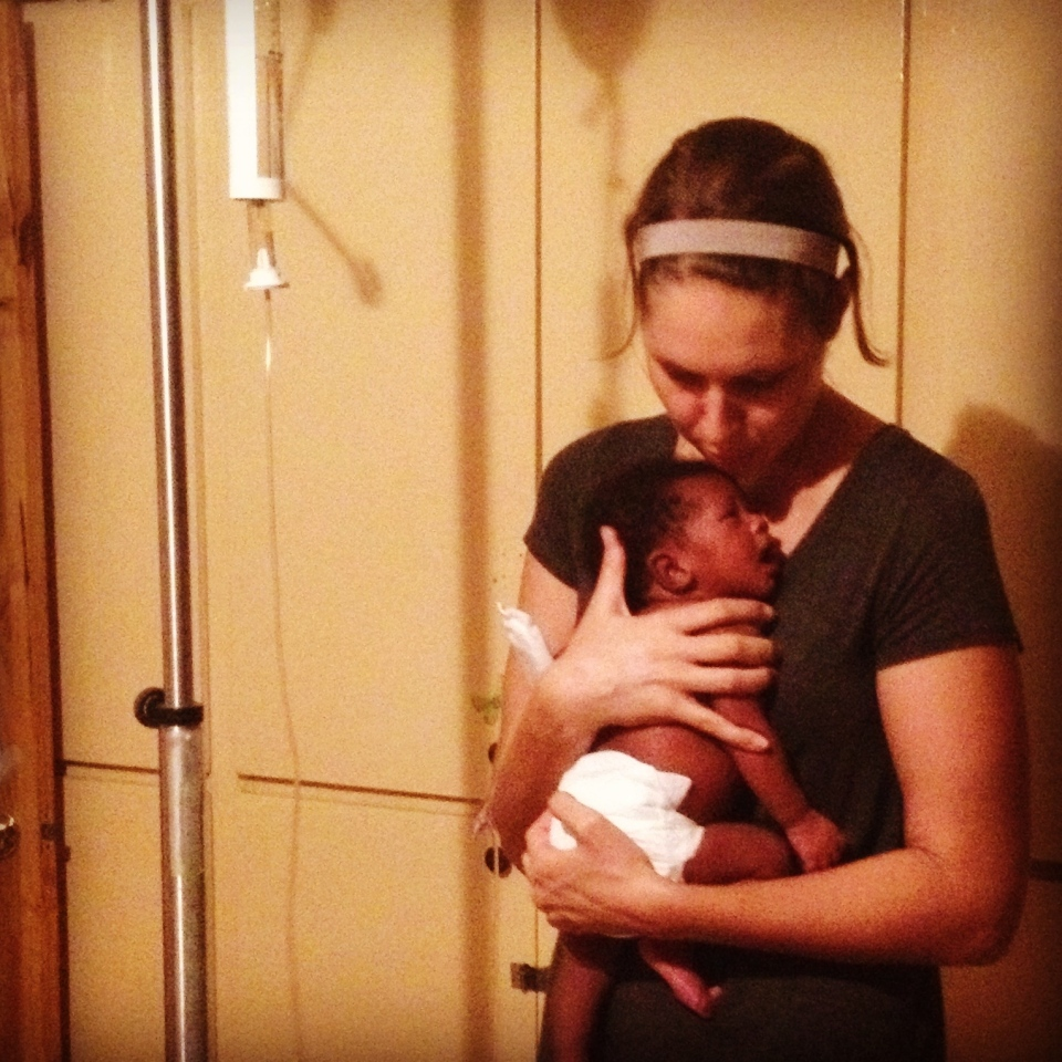 Dr. Jennifer Halverson is shown caring for a Haitian infant who was infected with the chikungunya virus during birth. (Provided)