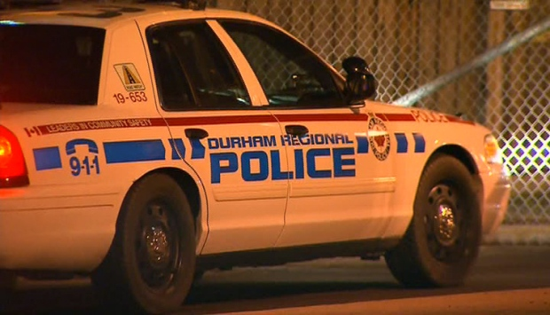 A Durham Regional Police cruiser arrives at the Toronto Police Service's 31 Division following early-morning raids across Toronto and the GTA, Tuesday, Dec. 13, 2011.