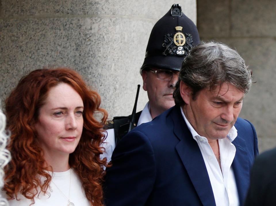 Rebekah Brooks, former News International chief executive, left, accompanied by her husband Charlie Brooks, leaves the Central Criminal Court in London, Tuesday, June 24, 2014. (AP / Lefteris Pitarakis)