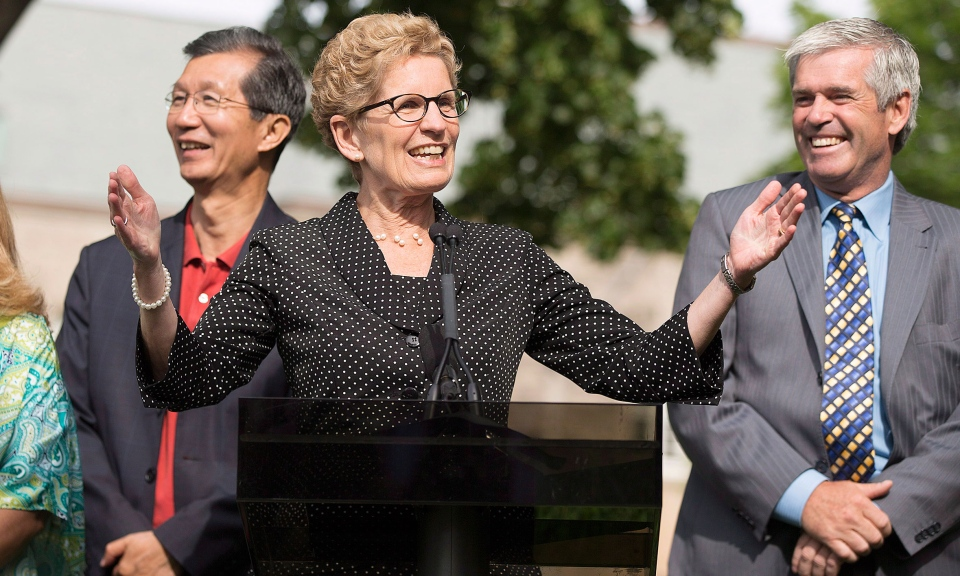 Ontario Premier Kathleen Wynne speaks at Queen's Park in Toronto on Monday, June 23, 2014. (Michelle Siu / THE CANADIAN PRESS)