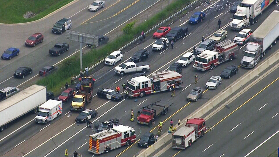 Emergency vehicles block off part of Highway 401 after a serious collision in Whitby, Ont. on Tuesday, June 24, 2014.