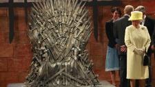 Queen Elizabeth beside the 'Iron Throne'