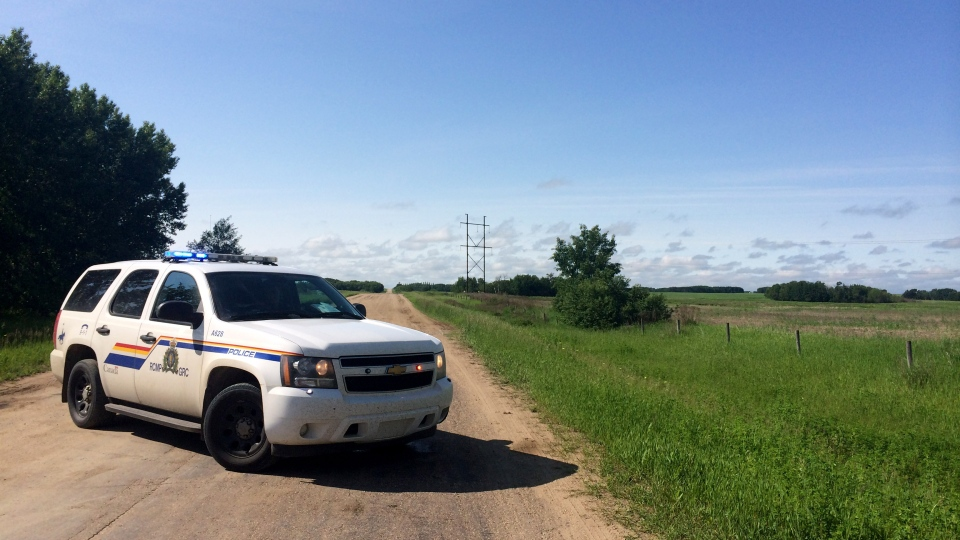 RCMP block Clarence Avenue, south of Saskatoon near Casa Rio, June 24, 2014 as police investigate a homicide.