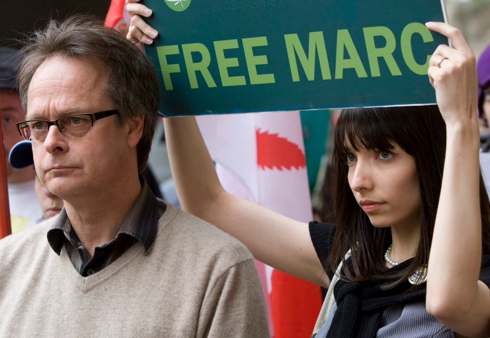 "Marc Emery, the self-described ""Prince of Pot"" speaks to reporters outside the B.C. Supreme Court in Vancouver, Monday, May 10, 2010 prior to turning himself in to be extradited to the United States as his wife Jodie, right, looks on. Emery pled guilty in connection to his Vancouver-based marijuana seed-selling business in return for a sentence of five years in prison. THE CANADIAN PRESS/Jonathan Hayward"