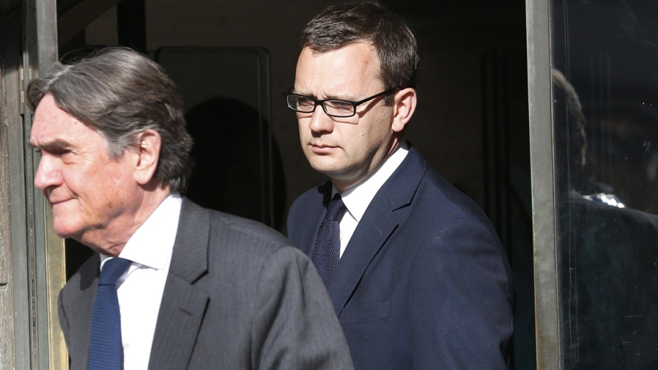 Andy Coulson, background, former News of the World editor leaves the Central Criminal Court in London, Tuesday, June 24, 2014. (AP / Lefteris Pitarakis)