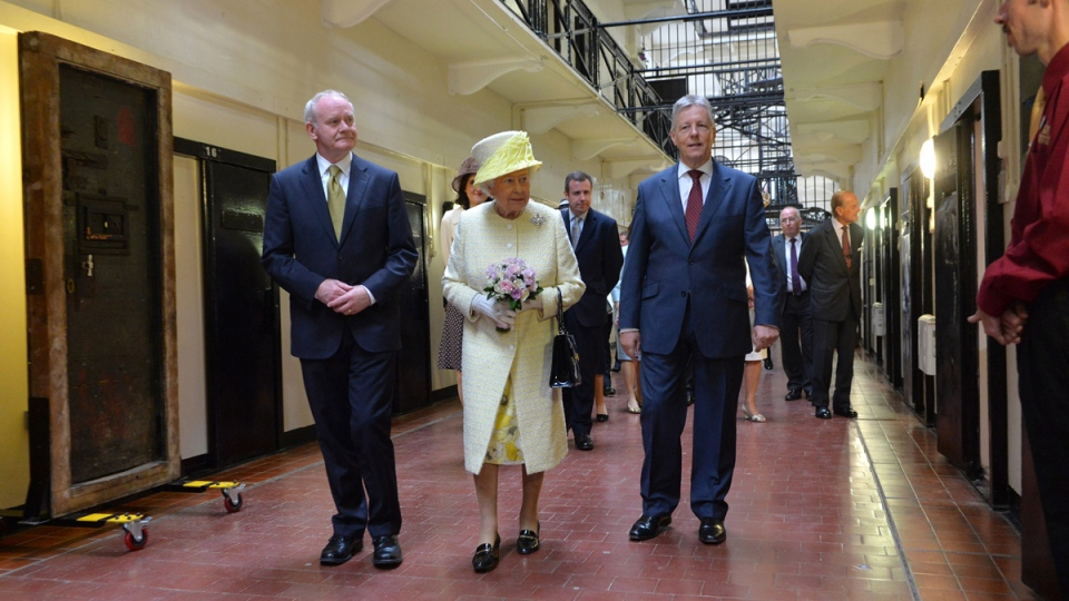 Queen Elizabeth II, centre, walks with Northern Ireland's First Minister Peter Robinson, right, and Deputy First Minister Martin McGuinness during a visit at the Crumlin Road jail in Belfast, Tuesday, June 24, 2014. (AP / Aaron McCracken)