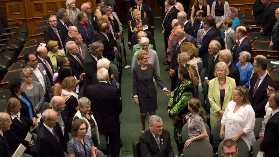 Premier Kathleen Wynne arrives to be sworn in