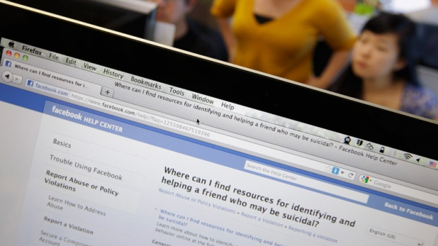 Facebook's User Operations Safety Team workers look at reviews at Facebook headquarters in Menlo Park, Calif., Tuesday, Dec. 13, 2011. (AP / Paul Sakuma)