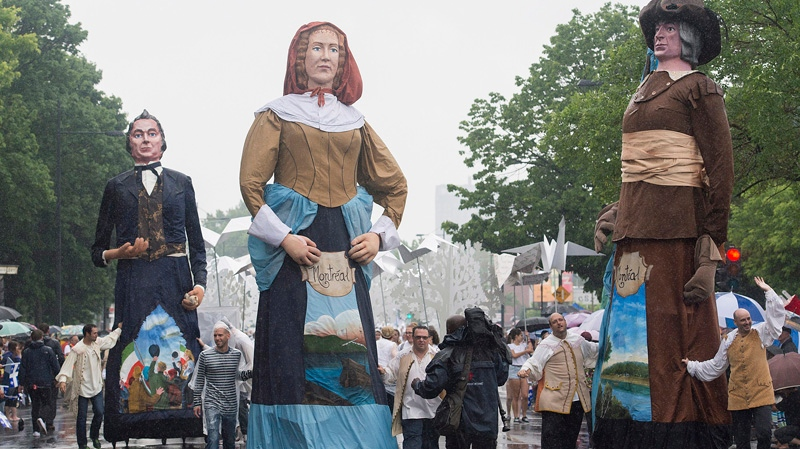 Participants entertain the crowds during the annual St-Jean-Baptiste Day parade in Montreal, Tuesday, June 24, 2014. THE CANADIAN PRESS/Graham Hughes
