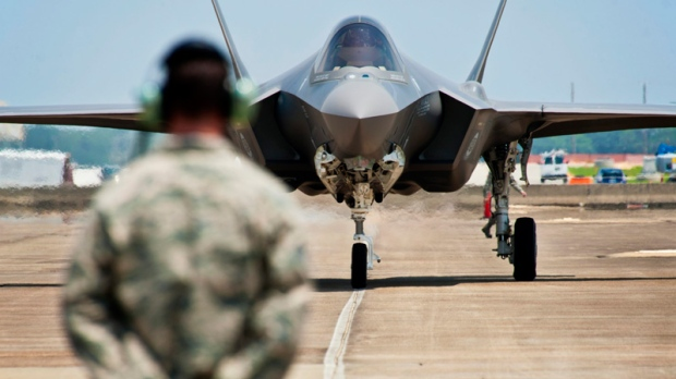 In this photo taken on July 14, 2011 and released by U.S. Air Force, Tech. Sgt. Brian West watches an F-35 Lightning II approach for the first time at Eglin Air Force Base, Fla. Japan's government has selected the Lockheed Martin F-35 stealth fighter to bolster its aging air force and is likely to announce the multibillion-dollar deal by the end of the week, news reports said Tuesday, Dec. 13, 2011. (U.S. Air Force, Samuel King Jr.)