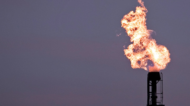 Gas burns from a flare stack at Imperial Oil's refinery in Dartmouth, N.S. on Tuesday, Dec. 13, 2011. (Andrew Vaughan / THE CANADIAN PRESS)