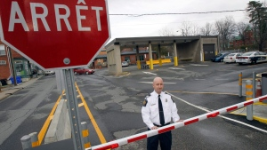 The chief of operations for the Canada Border Services Agency's Stanstead sector stands at the Canadian port of entry in Stanstead, Que., Nov. 14, 2012. (AP / Toby Talbot)