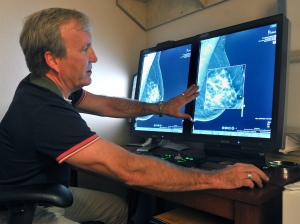 Radiologist Dr. Paul Bice compares an image from earlier, 2-D technology mammogram to the new 3-D Digital Breast Tomosynthesis mammography Tuesday, July 31, 2012 in Wichita Falls, Texas. (AP Photo/The Wichita Times-Record-News,Torin Halsey)
