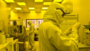 Researchers work in a clean room at the expanded University of Michigan Lurie Nanofabrication Facility, Thursday, April 10, 2008, in Ann Arbor, Mich. (AP Photo/Tony Ding)