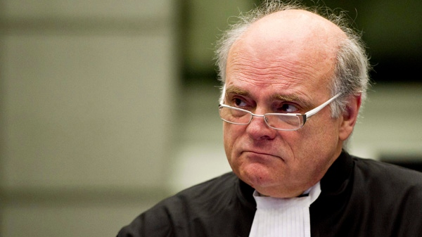 Prosecutor Daniel Bellemare of Canada looks up in the court room of the Hariri tribunal in Leidschendam, Netherlands, Monday Feb. 7, 2011. (AP /Valerie Kuypers)