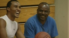 Jordan and his father, Joel Tyrrell, share a laugh on the sidelines of the JAC basketball court (Dec. 14, 2011)