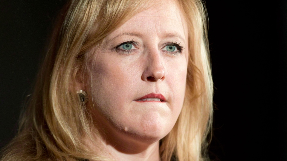 Former transportation Minister Lisa Raitt addresses a news conference in Ottawa, Monday, May 26, 2014. (Adrian Wyld / THE CANADIAN PRESS)
