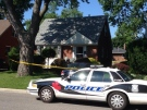 A Windsor police cruiser sits in front 955 Reedmere Road, as officials investigate an attempted murder on Thursday, June 26, 2014. (Dan Appleby/ CTV Windsor)