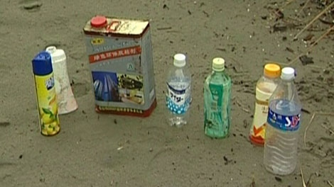 For the past few days a variety of bottles, cans and even pieces of lumber with Japanese writing have been carried by currents and the wind up to Tofino. Dec. 15, 2011. (CTV)