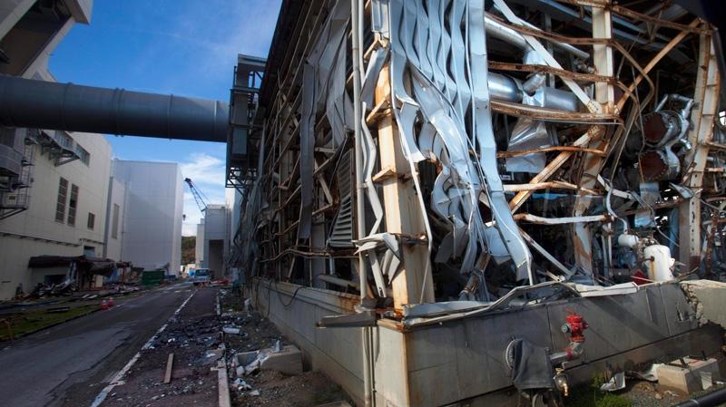 The crippled Fukushima Dai-ichi nuclear power station is seen through a bus window in Okuma, Japan, Saturday, Nov. 12, 2011. (AP / David Guttenfelder)