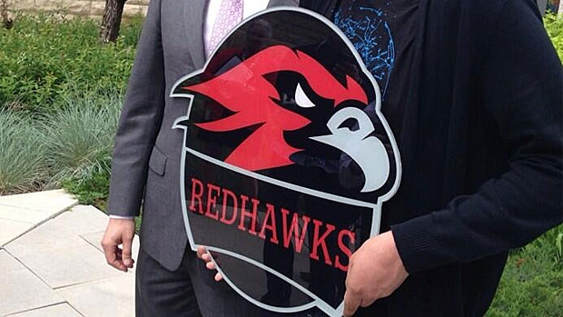 Western Canada High School officially retired the 'Redmen' name and logo on Thursday, adopting the new 'Redhawks' name and logo instead.