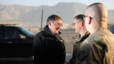 U.S. Sec. of Defense Leon Panetta, left, shakes hands with Lt. Gen. Curtis M. Scaparrotti, Commander of the ISAF Joint Command and Deputy Commander of US Forces in Afghanistan, right, during his departure from Kabul, Afghanistan, Thursday, Dec., 15, 2011. (AP / Pablo Martinez Monsivais)