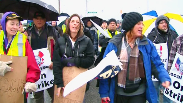 Transit workers picket in the streets in Newmarket, Thursday, Dec. 15, 2011.
