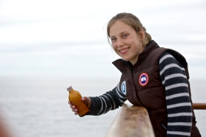 Saskia Vaisey, a Canadian student, drops a message in a bottle into the Arctic Ocean. The message was recently discovered in Ireland. (Students on Ice)
