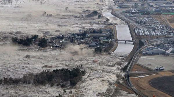 Earthquake-triggered tsumanis sweep shores along Iwanuma in northern. The magnitude 8.9 earthquake slammed Japan's eastern coast, unleashing a 4-metre tsunami that swept boats, cars, buildings and tons of debris miles inland, March 11, 2011. (Kyodo News)