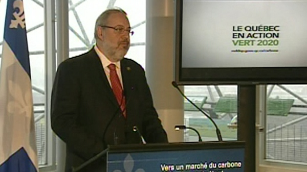 Environment minister Pierre Arcand announces the cap-and-trade greenhouse gas trading program. (Dec. 15, 2011)