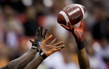 Calgary Stampeders' Ryan Steed, right, breaks up a pass intended for B.C. Lions' Stephen Adekolu in the end zone during the second half of a preseason game. (AP Photo/The Canadian Press, Darryl Dyck, File)