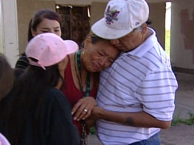 Delena Lefthand's parents are consoled by friends at the Samson reserve in Hobbema, Alta., on Monday, Aug. 18, 2008.