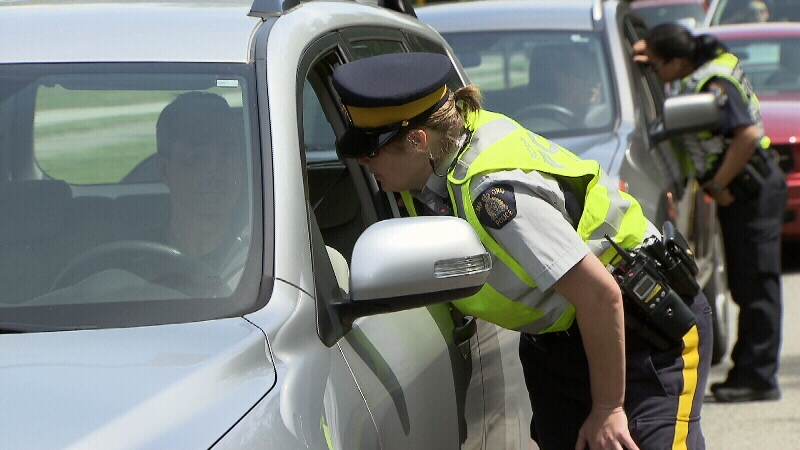 Police are seen speaking to drivers during a Counter Attack campaign in Metro Vancouver.