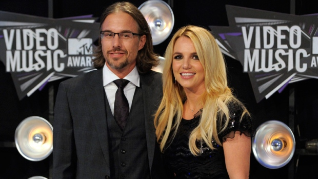 Jason Trawick, left, and Britney Spears arrive at the MTV Video Music Awards on Sunday Aug. 28, 2011, in Los Angeles. (AP Photo/Chris Pizzello)