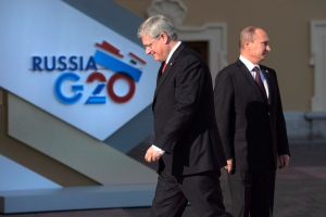 Canadian Prime Minister Stephen Harper walks past Russian President Vladimir Putin at the G20 Summit on Thursday, Sept.5, 2013 in St.Petersburg, Russia. The Harper government is snubbing officials from a select group of pariah states, ordering its diplomatic missions around the world not to invite them to receptions celebrating Canada Day on July 1. (Adrian Wyld / THE CANADIAN PRESS)