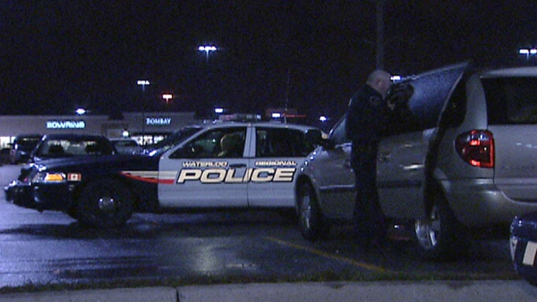 Police work at the scene of a series of thefts at the Smart Centre on Pinebush Road in Cambridge, Ont. on Thursday, Dec. 15, 2011.